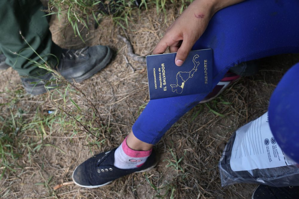 El Salvadorian immigrant children are interviewed by Border Patrol agents after their Central American families crossed the Rio Grande from Mexico into the United States to seek asylum on April 14, 2016 in Roma, Texas. (John Moore/Getty Images)