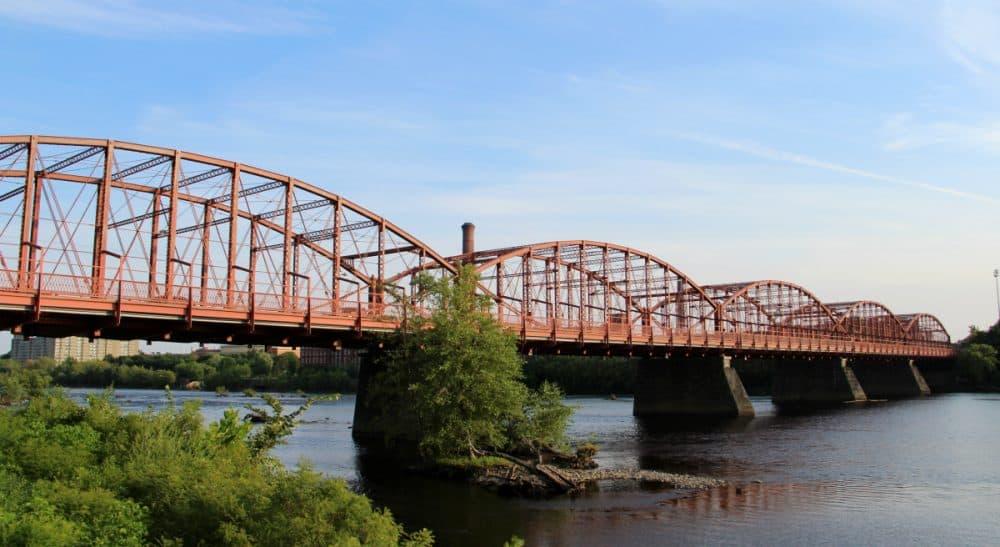 The historic Aiken Street Bridge over the Merrimack River in Lowell, Massachusetts. (cmh2315fl/Flickr)