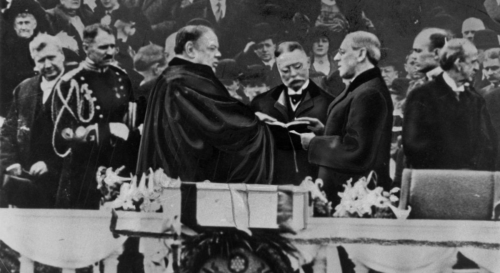 """Tim Snyder: """"If Wilson's name were to be removed at Princeton, would the students, faculty and staff there be closer to racial equality?"""" Pictured: Woodrow Wilson takes the oath of office for his first term as President on March 4, 1913. On Monday, April 4, 2016, Princeton University announced that, after months of scholarly examination of the famous alumnus's legacy, the Wilson name will remain, but new programs to promote transparency, diversity and racial equality on campus will be implemented.  (File/AP)"""