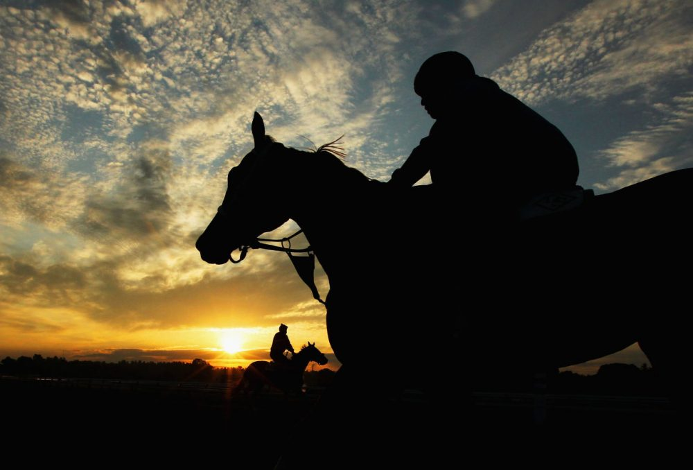 While some aspiring sportswriters strive to cover the world's biggest events, Bill finds inspiration in the less-celebrated things, like a sunrise at Saratoga Race Course. (Al Bello/Getty Images)