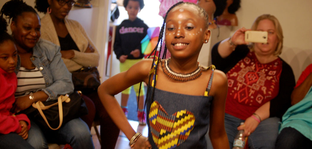"""Danay Almond models during the """"Rock My Locs"""" hair show. (Greg Cook)"""