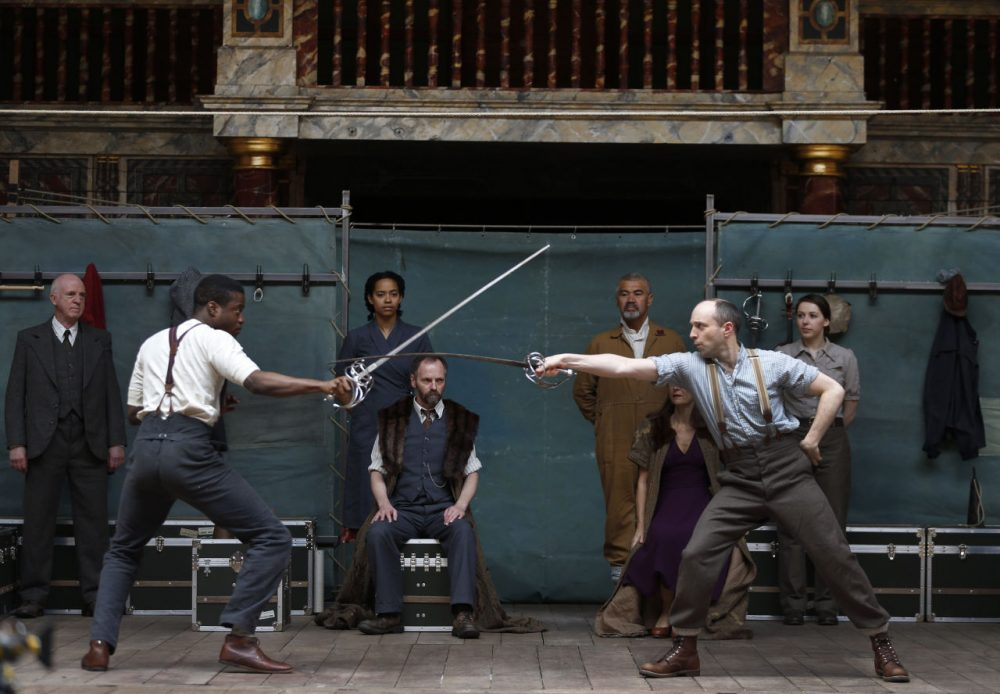 """Actors from London's Globe Theatre perform a scene from William Shakespeare's 'Hamlet' before setting out to test the Bard's maxim that """"all the world's a stage"""" by taking 'Hamlet' to 200 countries around the world. (AP Photo/Lefteris Pitarakis)"""
