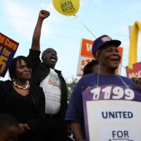 Demonstrators gather together at a McDonalds restaurant as they demand an increase in the minimum wage to $15 an hour on April 14, 2016 in Miami, Florida.  (Joe Raedle/Getty Images)