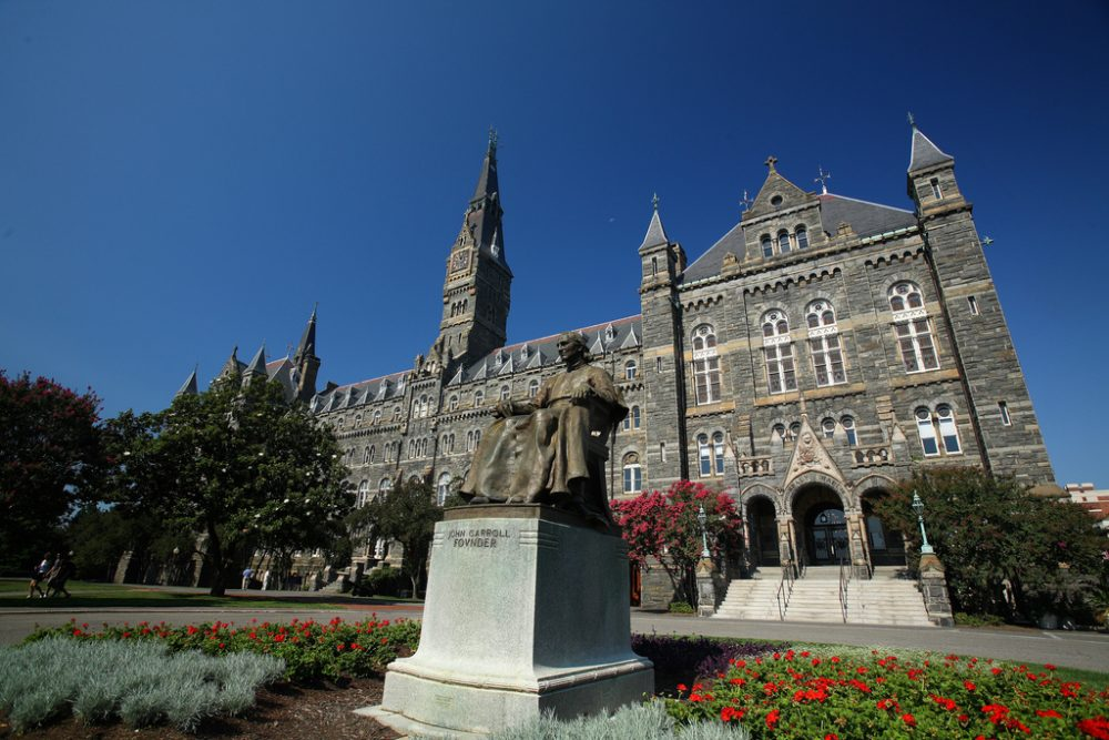 Healy Hall at Georgetown University in Washington, D.C., and a statue of Georgetown's founder, John Carroll. (ehpien/Flickr)