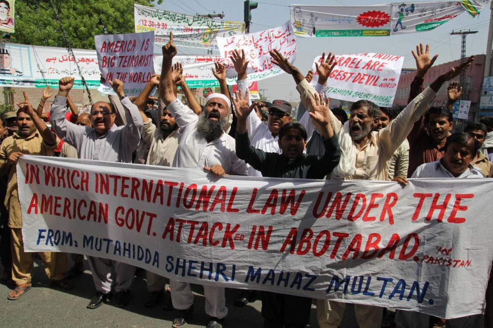Pakistani protesters from the United Citizen Action (UCA) group shout anti-US slogans during a protest on the third anniversary of the death of slain Al-Qaeda leader Osama bin Laden, in Multan on May 2, 2014. The al-Qaeda founder Osama bin Laden and 9/11 mastermind was killed on May 2, 2011 in a secret US Navy SEAL operation in a walled-off compound in the Pakistani garrison town of Abbottabad, north of the Pakistani capital. AFP PHOTO/ SS MIRZA        (SS Mirza/AFP/Getty Images)