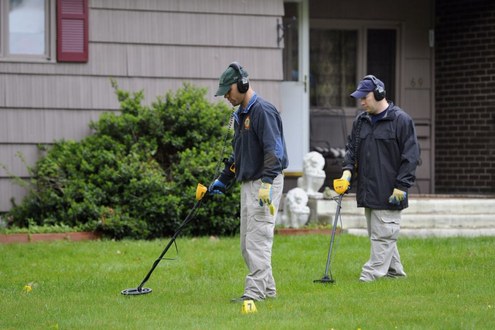 Law enforcement agents search the yard at Robert Gentile's Manchester, Conn. home in 2012. (Jessica Hill/AP)