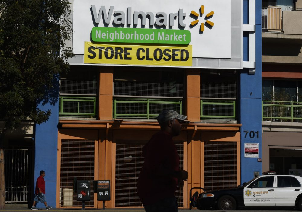 A man walks past a recently shuttered Walmart store in Chinatown that is part of the closure of 154 store locations across the United States, in Los Angeles, California on January 28, 2016. The US retailing giant Walmart recently announced it is shuttering 269 stores inside and outside the United States, with Latin America the hardest-hit foreign market. (Mark Ralston /AFP/Getty Images)