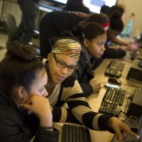 With the assistance of volunteers and other instructors, members of the Brookview House Girls Who Code Club meet every Wednesday to hone basic coding skills. (Jesse Costa/WBUR)