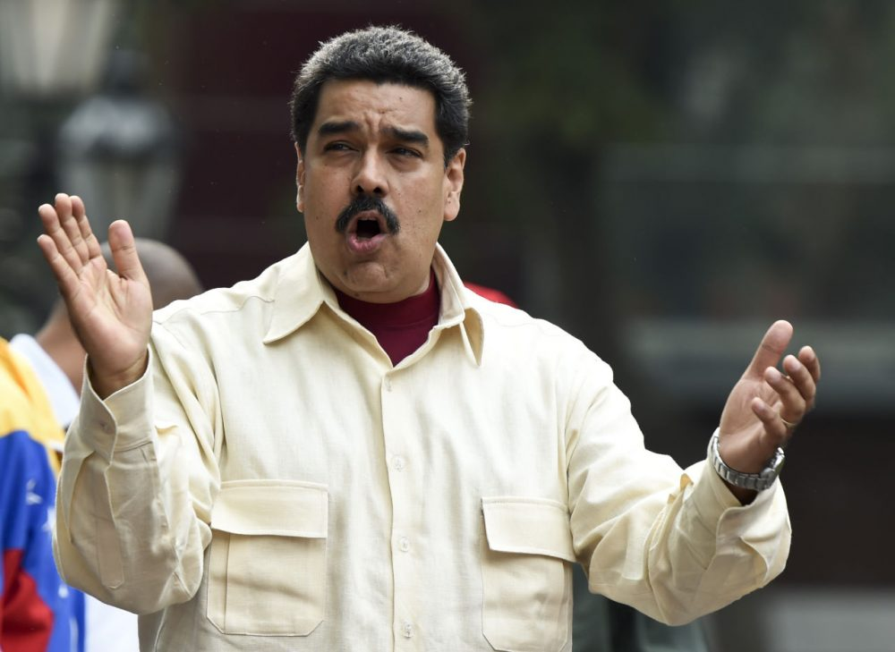 Venezuelan President Nicolas Maduro gestures at supoorters during a demonstration in Caracas on April 19, 2016.  Venezuelan President Nicolas Maduro's six-year term reaches midpoint on Tuesday, a date few have been anticipating more eagerly than the country's opposition, which will now be able to initiate a recall referendum. (Juan Barreto/AFP/Getty Images)