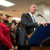 New York City Mayor Bill de Blasio announces his plan to raise the minimum wage for all city workers to $15 per hour on January 6, 2016 in New York City. The plan will effect approximately 50,000 city workers and will be fully phased in by 2018.  (Andrew Burton/Getty Images)