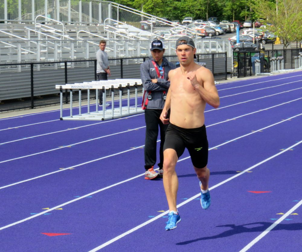 Olympic half-miler Nick Symmonds flies past his Brooks Beasts team coach Danny Mackey during training in Seattle. (Tom Banse/NWW)