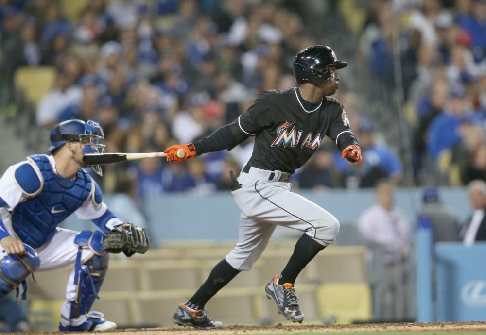Dee Gordon, #9 of the Miami Marlins hits an RBI single in the seventh inning against the Los Angeles Dodgers at Dodger Stadium on April 28, 2016 in Los Angeles, California. (Stephen Dunn/Getty Images)