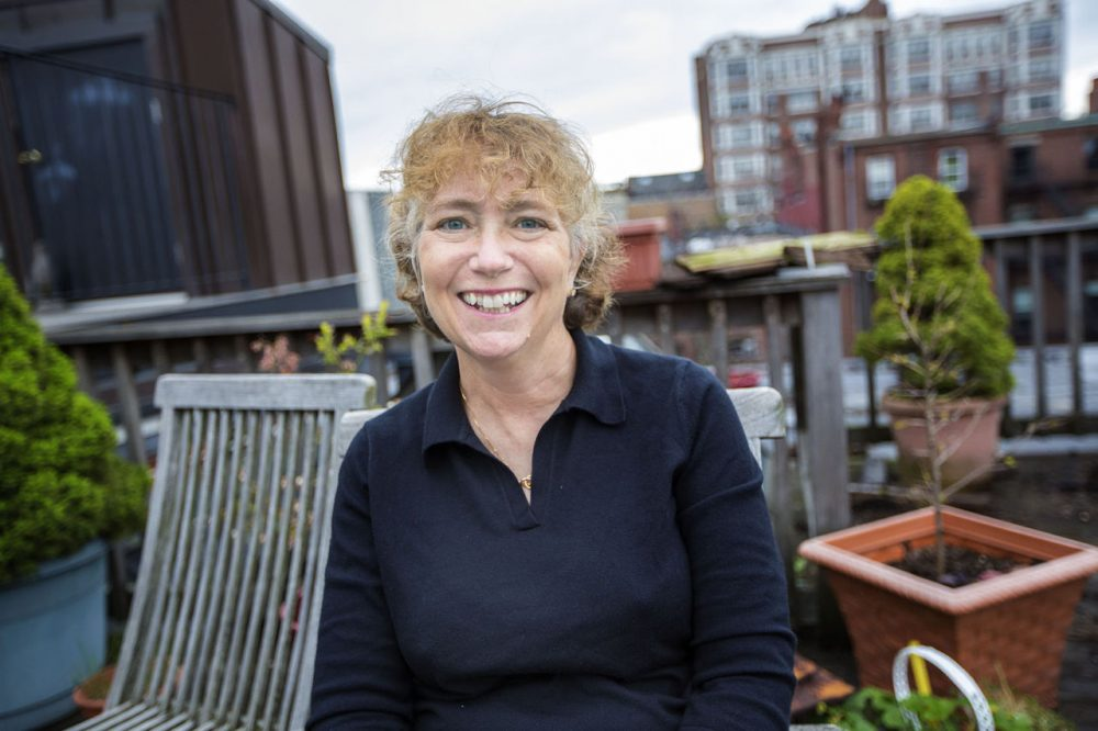 Caroline Reeves on her rooftop in Boston in 2016. (Jesse Costa/WBUR)