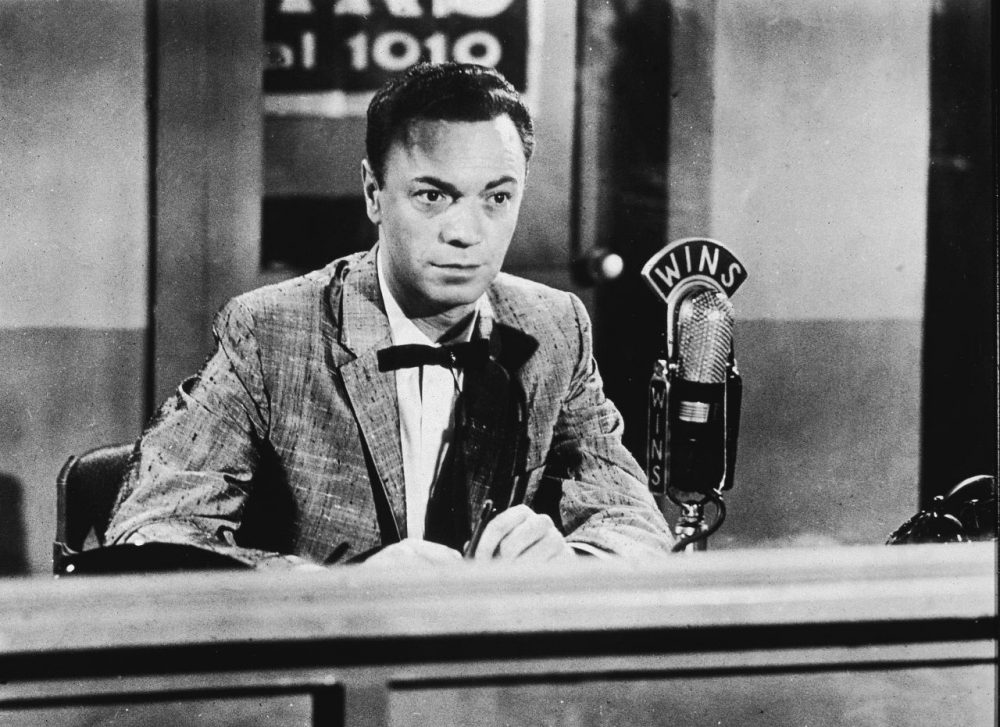 American disc jockey and radio performer Alan Freed (1921 - 1965) who coined the term rock 'n' roll sits in a 1010 WINS sound studio during a radio broadcast, 1950s. (Hulton Archive/Getty Images)