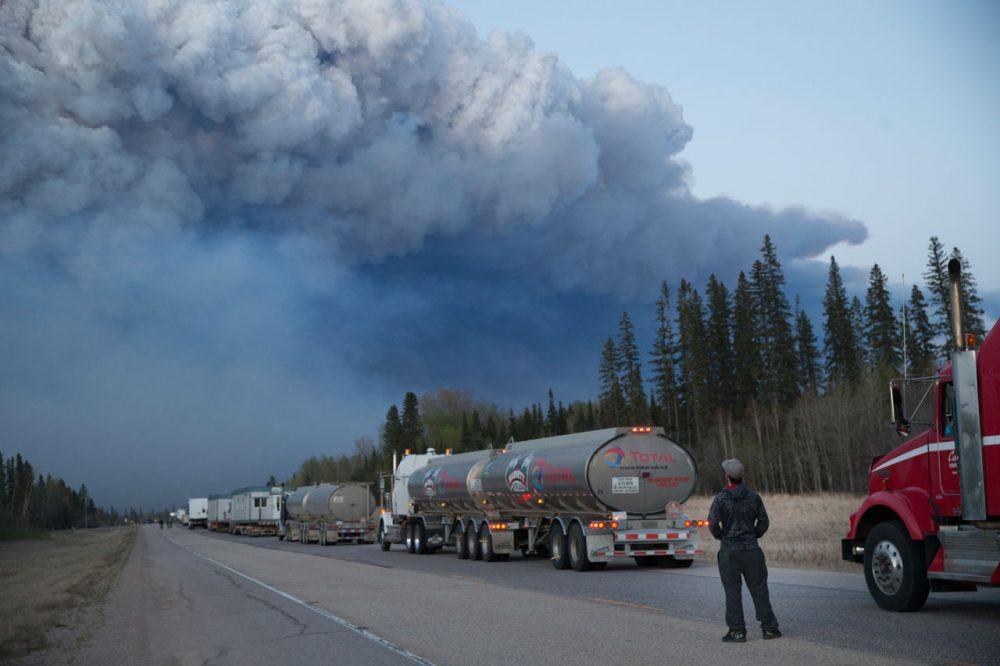 Drivers wait for clearance to take firefighting supplies into town on May 05, 2016 outside of Fort McMurray, Alberta. Wildfires, which are still burning out of control, have forced the evacuation of more than 80,000 residents from the town.   (Scott Olson/Getty Images)