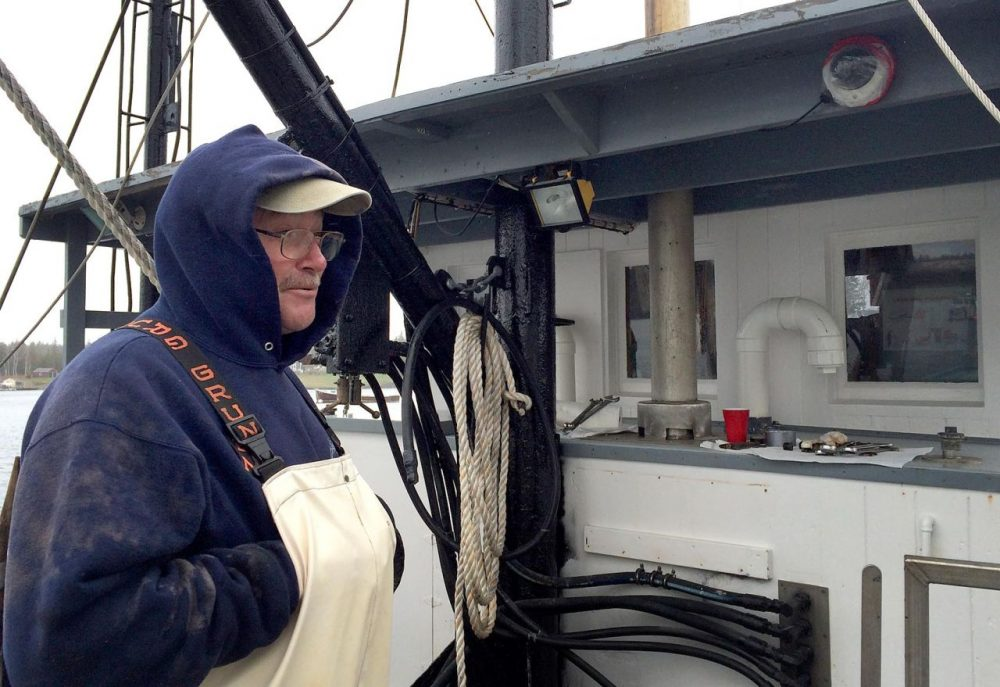 Randy Cushman is aboard his fishing vessel Ella Christine, in Port Clyde, Maine. In the top righthand corner, you can see one of the cameras used to monitor his catch and fishing activities. (Qainat Khan/WBUR)