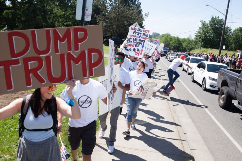 Protesters gather outside the venue prior to a Republican presidential candidate Donald Trump rally at the The Northwest Washington Fair and Event Center on May 7, 2016 in Lynden, Washington. (Matt Mills McKnight/Getty Images)