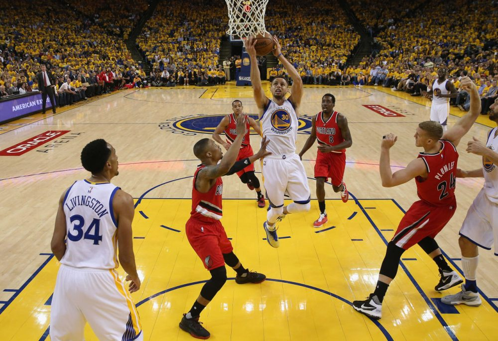 Stephen Curry #30 of the Golden State Warriors goes up for a shot against the Portland Trail Blazers during Game Five of the Western Conference Semifinals during the 2016 NBA Playoffs on May 11, 2016 at Oracle Arena in Oakland, California. (Ezra Shaw/Getty Images)