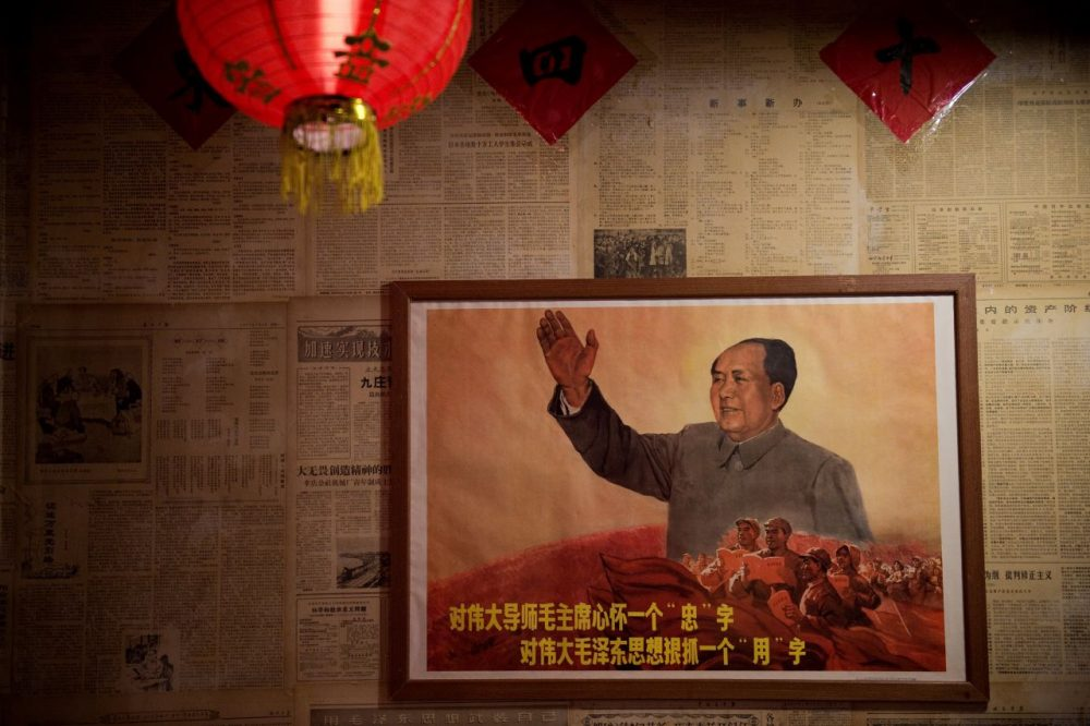 A poster showing the late Chinese chairman Mao Zedong hangs on a wall inside a restaurant in Beijing on May 13, 2016. Fifty years after the Cultural Revolution spread bloodshed and turmoil across China, the Communist-ruled country is driving firmly down the capitalist road, but Mao Zedong's legacy remains -- like the embalmed leader himself -- far from buried. (Nicolas Asfouri/AFP/Getty Images)