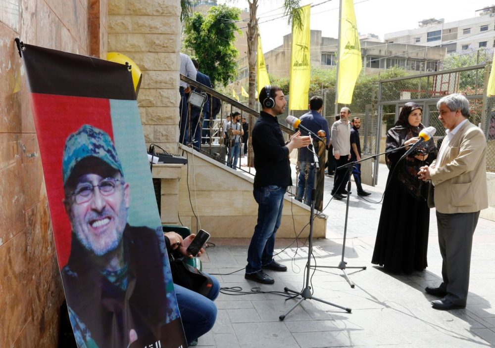 Lebanese press report from outside where family members are receiving condolences for the death of top Hezbollah commander Mustafa Badreddine who was killed in an attack in Syria in a southern suburb of Beirut on May 13, 2016.  Lebanese militant group Hezbollah announced that its top military commander had been killed in an attack in Syria in a major blow to the coalition supporting the Damascus regime.  (Anwar Amro/AFP/Getty Images)