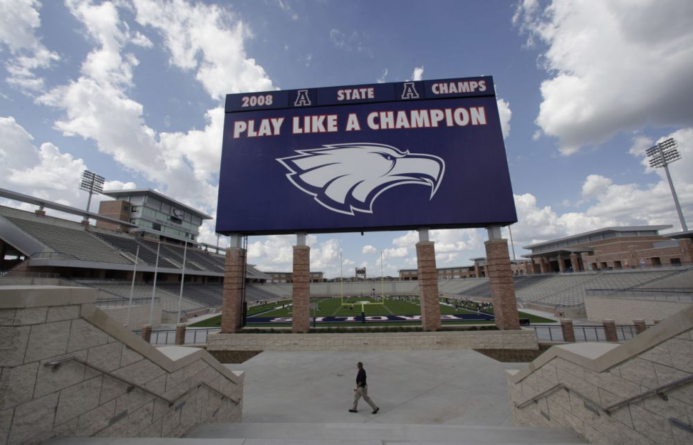 FILE -In this Aug. 28, 2012 file photo, the scoreboard is shown at Eagle Stadium at Allen High School in Allen, Texas. This suburban Dallas school district grabbed national attention in 2012 when it opened an eye-popping $60 million high school football stadium. Are such exorbitant price tags for high school stadiums the new normal? Only in Texas, it seems.  (AP Photo/LM Otero, File)