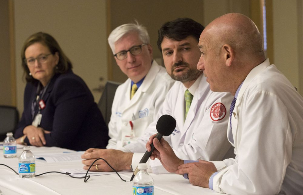 Dr. Joshua Safer speaks at a press briefing at Boston Medical Center as Kate Walsh, president and CEO of BMC, Dr. Gerard Doherty, chief of surgery,  and Dr. Jaromir Slama, chief of plastic surgery look on. (Jesse Costa/WBUR)
