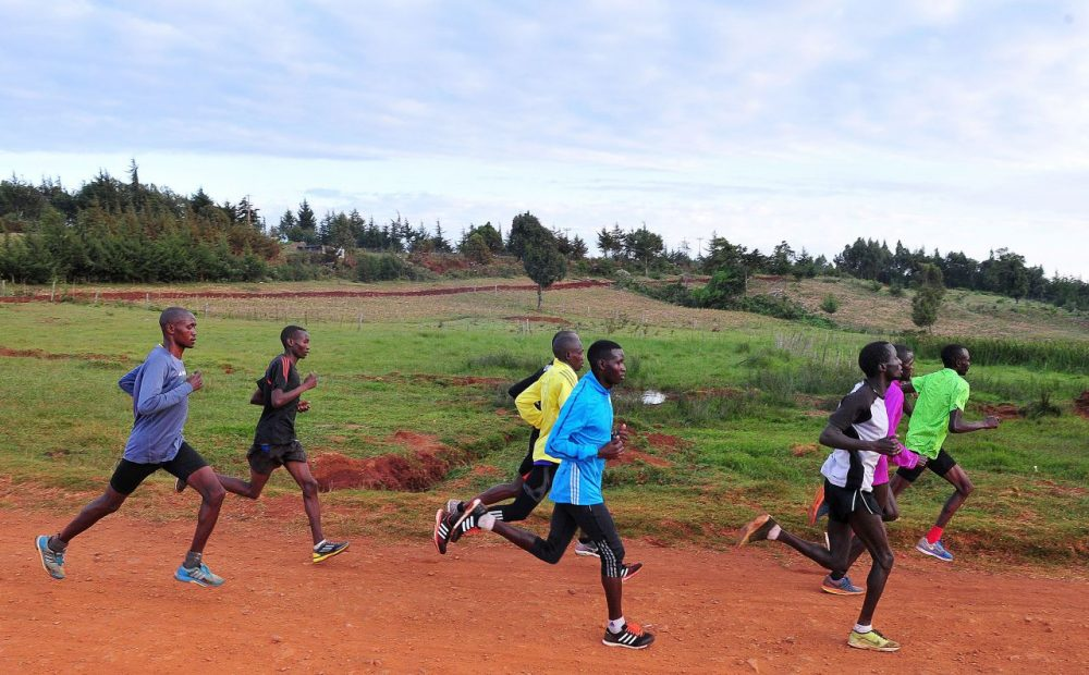 "Kenyan athletes run during a training session in Iten in the Rift Valley, 329 kms north of Nairobi, on January 13, 2016. The scandal gripping athletics promises to worsen with the publication of a second explosive report on January 14 targeting corrupt ""scumbags"" and a leaked blood database that could have worldwide ramifications for track and field. The second report by the World Anti-Doping Agency (WADA) independent commission is understood to include shocking revelations of endemic corruption within IAAF and leading athletics federations other than Russia, such as track powerhouses Kenya. (Simon Maina/AFP/Getty Images)"