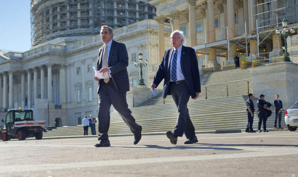 On Wednesday, Nov. 4, 2015, Democratic presidential candidate Sen. Bernie Sanders, I-Vt., right, and Sen. Jeff Merkley, D-Ore. walked to a news conference on Capitol Hill in Washington to announce new climate legislation. (Pablo Martinez Monsivais/AP)