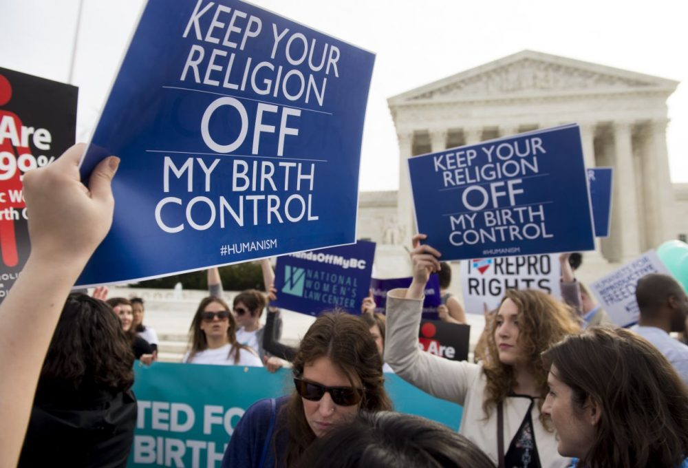 Supporters of women's health rally outside the Supreme Court in Washington, DC, March 23, 2016, as the Court hears oral arguments in 7 cases dealing with religious organizations that want to ban contraceptives from their health insurance policies on religious grounds. (Saul Loeb/AFP/Getty Images)