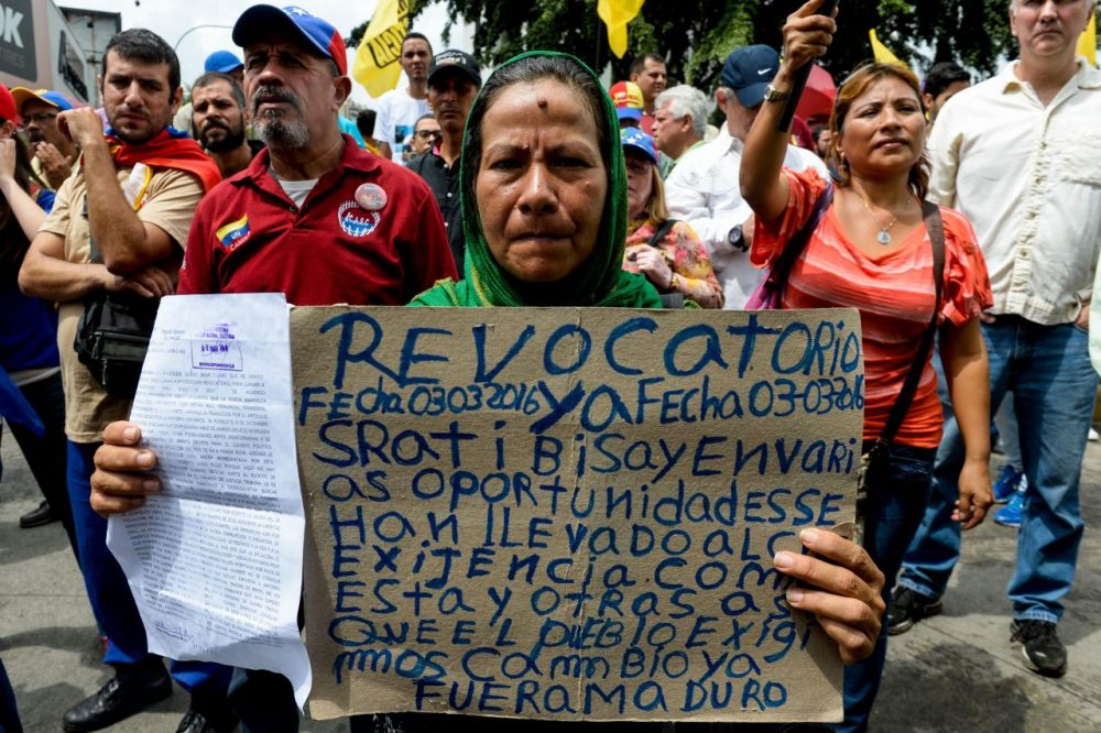"""Opponents of the government of Venezuelan President Nicolas Maduro take part in a demonstration in Caracas on May 14, 2016. Venezuela braced for protests Saturday after Maduro declared a state of emergency to combat the """"foreign aggression"""" he blamed for an economic crisis that has pushed the country to the brink of collapse. (Federico Parra/AFP/Getty Images)"""