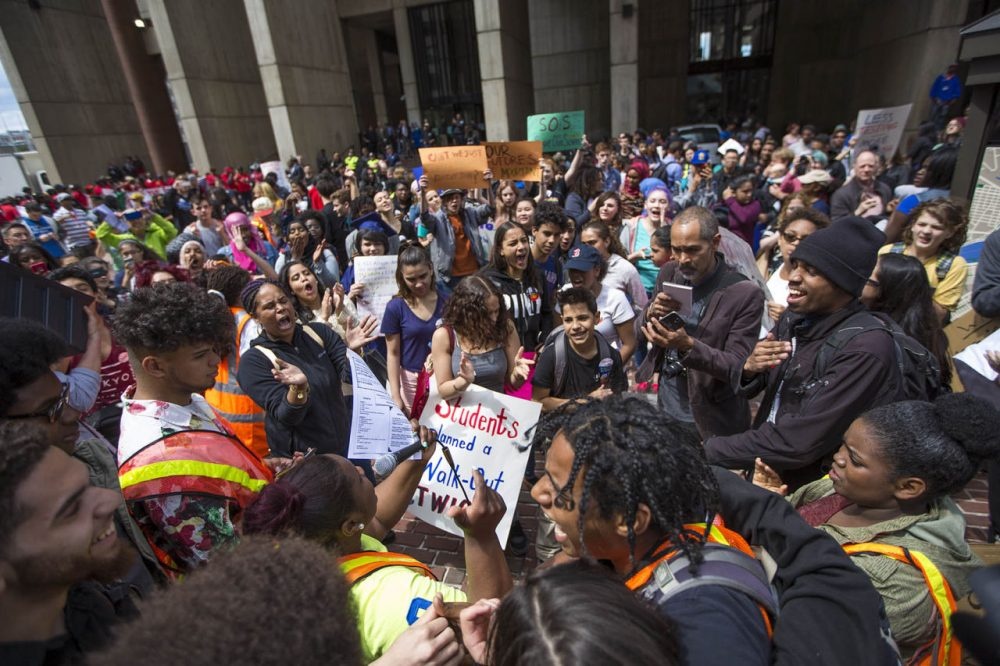 Boston Public School students and parents protest proposed budget cuts outside Boston City Hall on Tuesday. (Jesse Costa/WBUR)