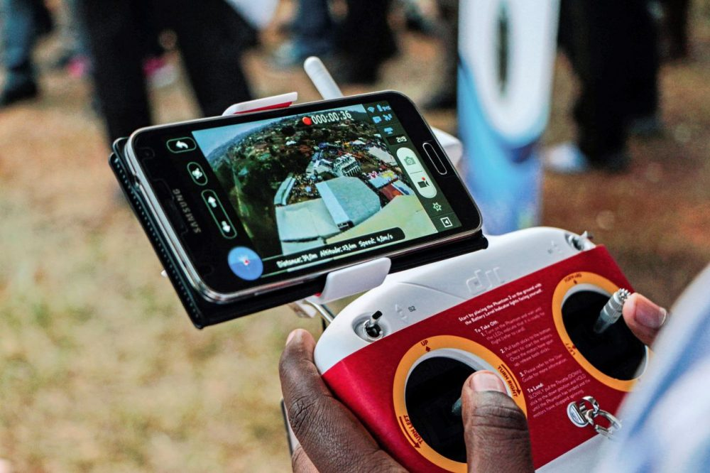 A photo taken on July 24, 2014 shows an aerial view displayed on a mobile phone synchronized to a tele-guided drone camera during an international trade fair in Kigali. Rwanda is  planning to construct a droneport in order to get drones to carry mostly medical urgent supplies from a central hub to rural areas around the country. (CYRIL NDEGEYA/AFP/Getty Images)