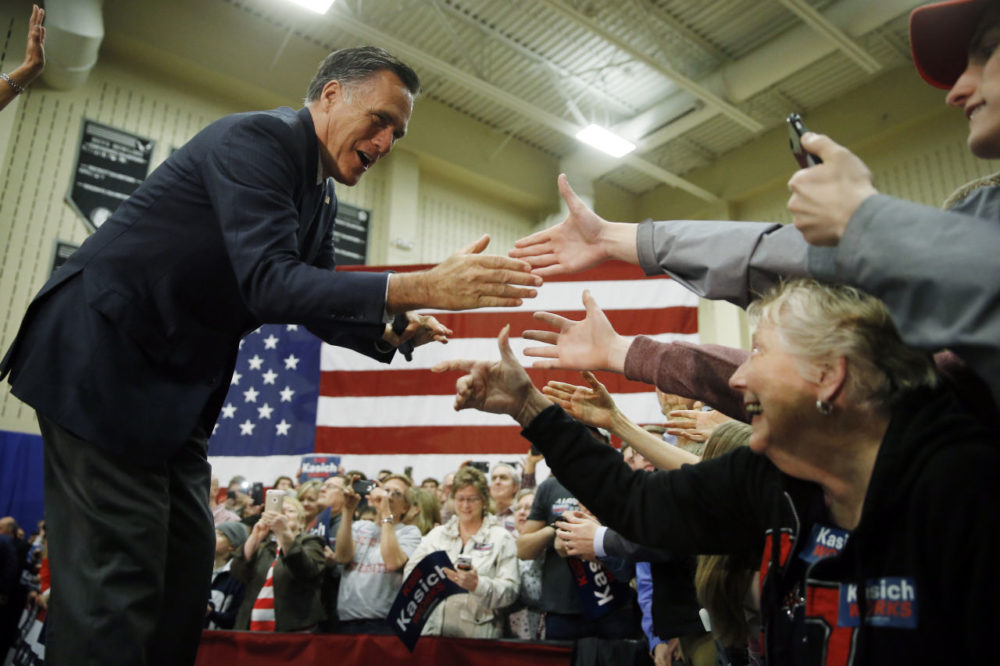 Former Republican presidential candidate Mitt Romney meets with attendees at a campaign stop for former Republican presidential candidate Ohio Gov. John Kasich in March in Westerville, Ohio. (Matt Rourke/AP)