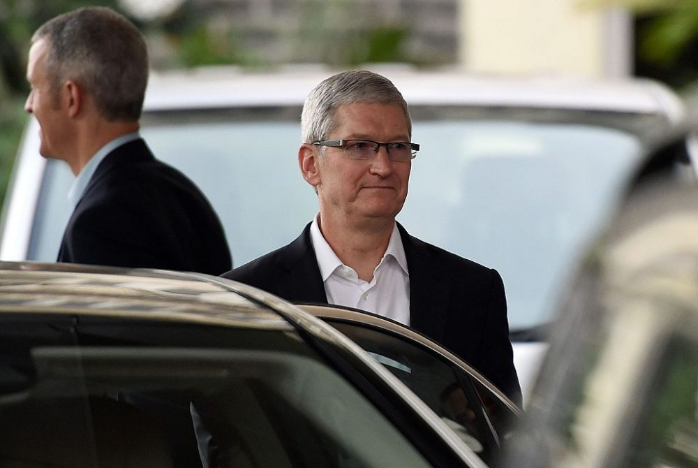 Apple chief executive Tim Cook (C) leaves the Taj Mahal Palace hotel in Mumbai on May 18, 2016. Apple chief executive Tim Cook announced May 18 a new app design centre in India as he kicked off his first visit to the Asian giant seeking to tap into its roll-out of 4G networks. Cook landed in the Indian financial capital Mumbai shortly before midnight on May 17 by private jet from China, where he made a $1 billion announcement. (PUNIT PARANJPE/AFP/Getty Images)