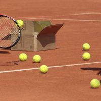 Players open a box of tennis balls during a training at Roland-Garros tennis stadium in Paris, on May 20, 2010, three days ahead of the French Open, the second Grand Slam tournament of the season.        AFP PHOTO JACQUES DEMARTHON        (Photo credit should read JACQUES DEMARTHON/AFP/Getty Images)