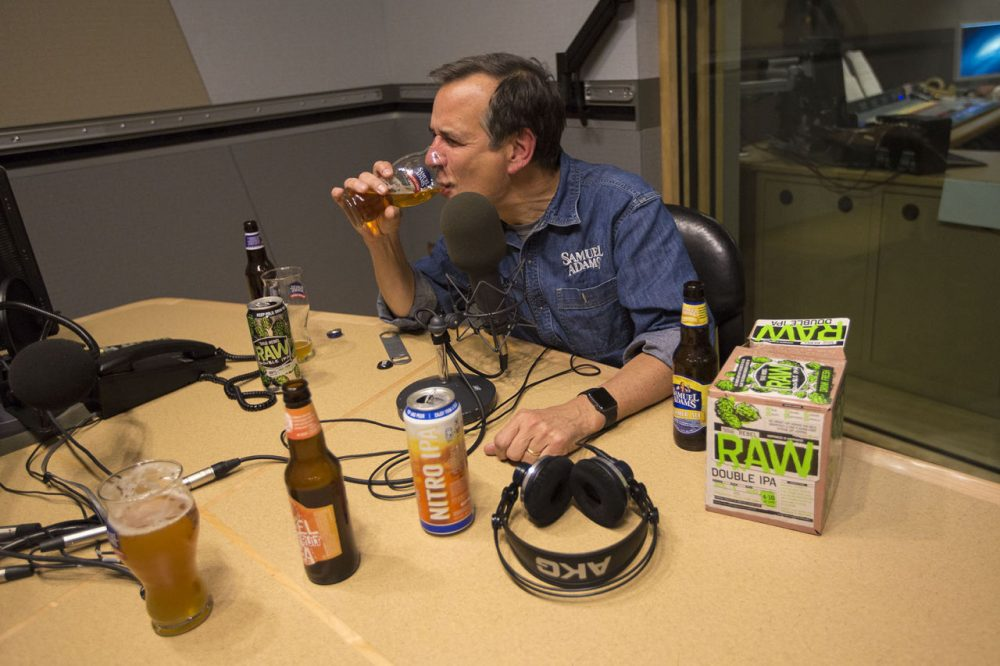 Jim Koch, founder of Boston Beer Company, which brews Samuel Adams Beer, tastes a glass of Boston Lager at the WBUR studios. (Jesse Costa/WBUR)