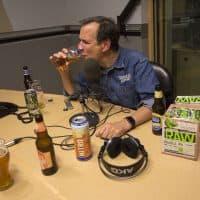 Jim Koch, founder of Boston Beer Company, which brews Samuel Adams Beer, tastes a glass of Boston Lager at the WBUR studios. (Jesse Costa/WBUR)