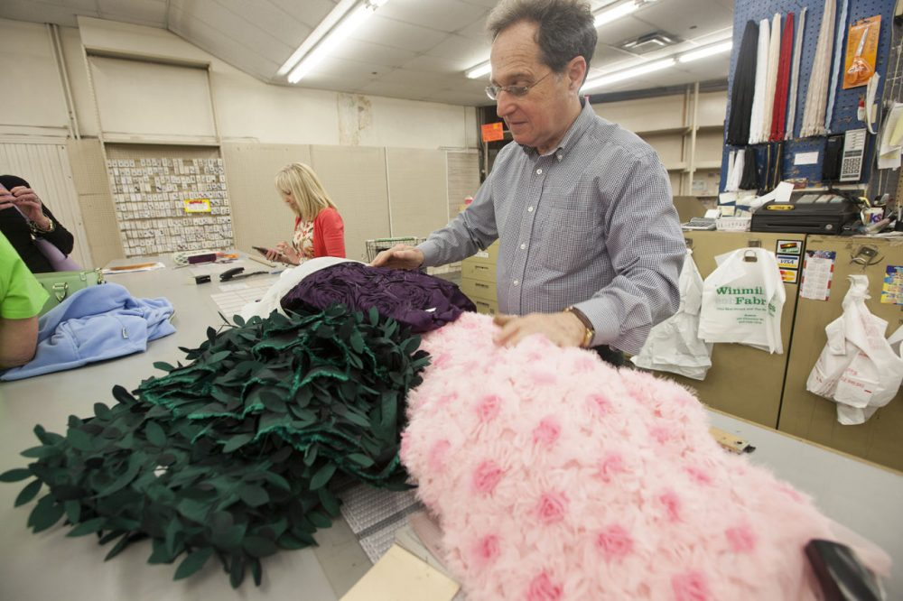 Howard and Marilyn Held, left, opened Winmil Fabrics in 1969. It closes next month. (Joe Difazio for WBUR)