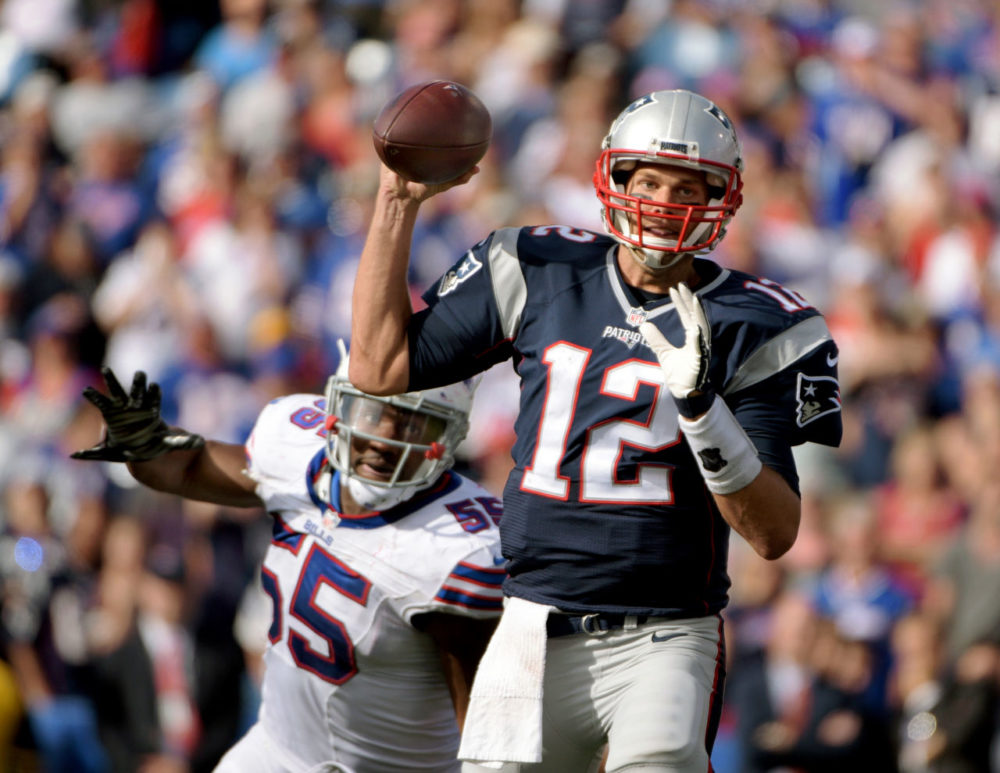 New England Patriots quarterback Tom Brady (12) throws under pressure by Buffalo Bills defensive end Jerry Hughes (55) during the second half of an NFL football game on Sunday. (Gary Wiepert/AP)