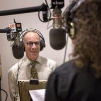 Co-hosts Dr. Eddie Phillips and CommonHealth's Carey Goldberg record The Magic Pill in a WBUR studio. Photo: Robin Lubbock)