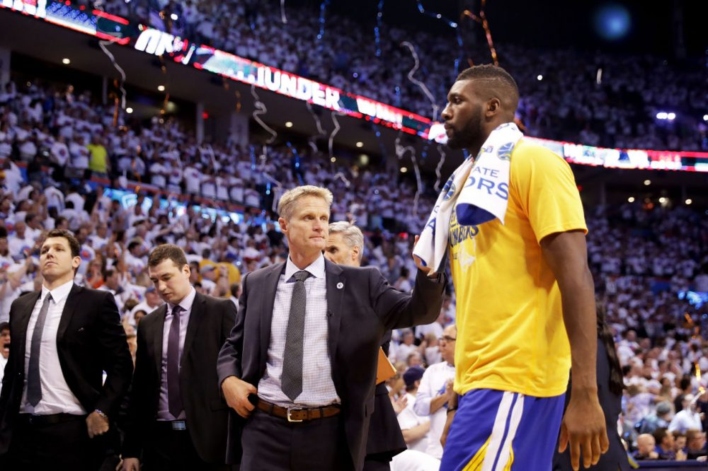 Festus Ezeli and head coach Steve Kerr of the Golden State Warriors walk off of the court after their 94 to 118 loss to the Oklahoma City Thunder in game four of the Western Conference Finals during the 2016 NBA Playoffs at Chesapeake Energy Arena on May 24, 2016 in Oklahoma City, Oklahoma. (Ronald Martinez/Getty Images)