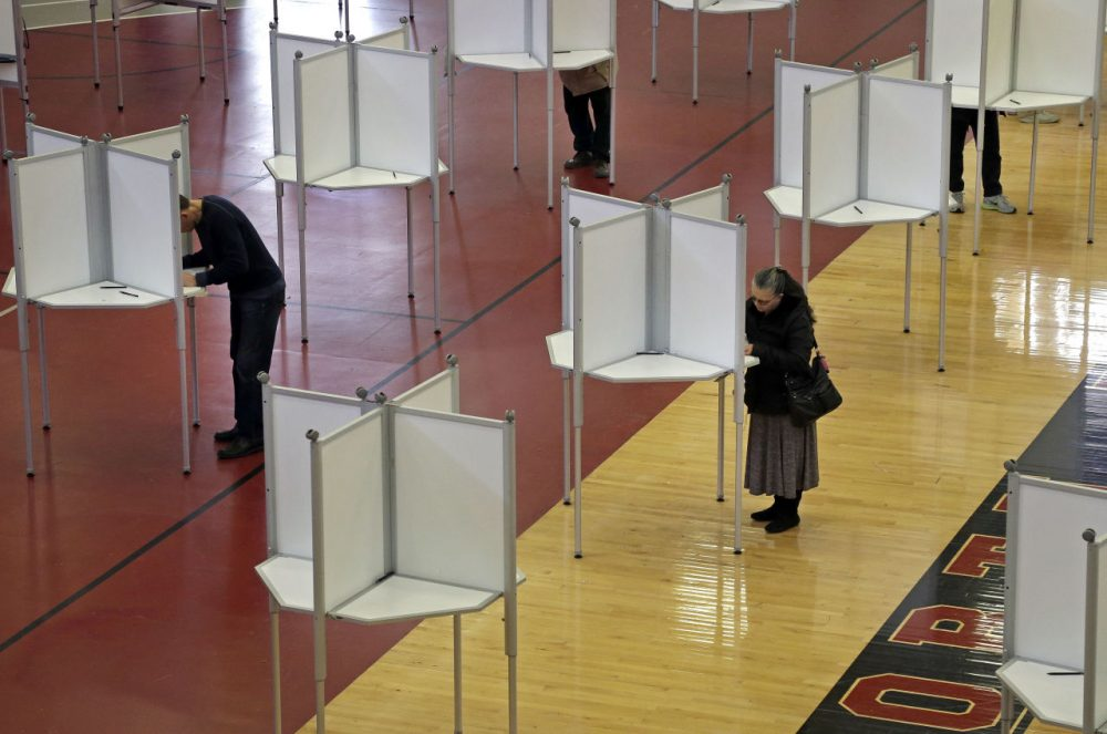 In North Reading, Mass., voters cast ballots at a polling station for Massachusetts' primary election held in March.  (Elise Amendola/AP)