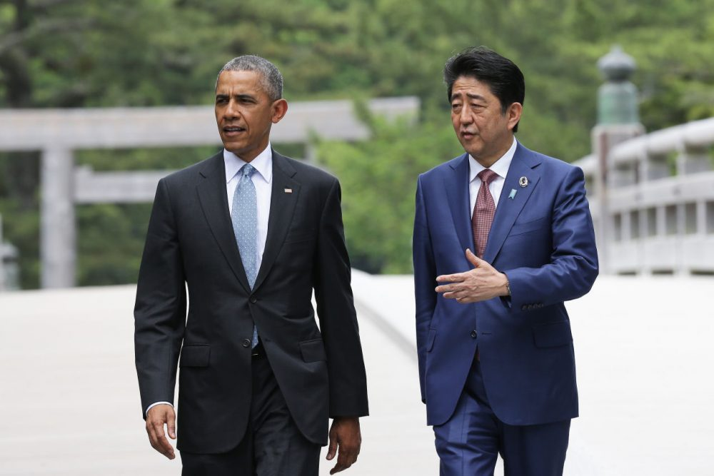 U.S. President Barack Obama walks with Japanese Prime Minister Shinzo Abe on the Ujibashi bridge as they visit at the Ise-Jingu Shrine on May 26, 2016 in Ise, Japan. In the two-day summit, the G7 leaders are scheduled to discuss the pressing global issues including counter-terrorism, energy policy, and sustainable development. (Chung Sung-Jun/Getty Images)