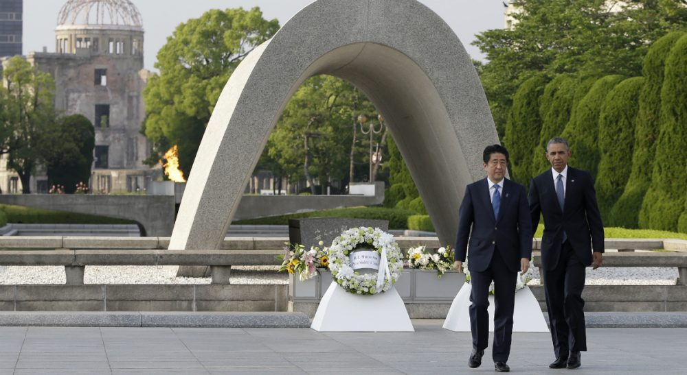 U.S. President Barack Obama and Japanese Prime Minister Shinzo Abe walk after laying wreaths at the cenotaph at Hiroshima Peace Memorial Park in Hiroshima, western Japan, Friday, May 27, 2016. President Obama visited Hiroshima on Friday, after the Group of Seven summit in central Japan, becoming the first sitting American president to do so. (Carolyn Kaster)