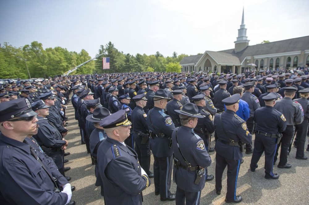 Hundreds of police officers stood outside the church were Ronald Tarentino's funeral was held Friday in Charlton. Tarentino, an Auburn police officer, was shot and killed during a traffic stop.  (Jesse Costa/WBUR)