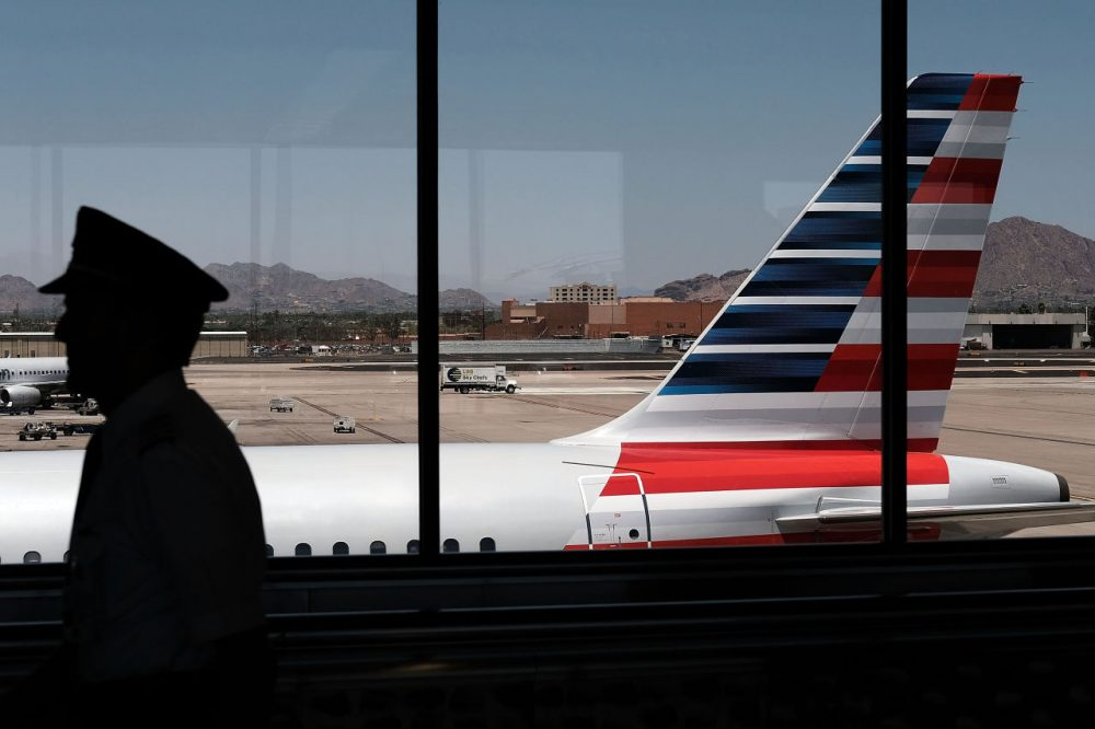 A pilot walks through the Phoenix airport on May 24, 2016 in Phoenix, Arizona. (Spencer Platt/Getty Images)