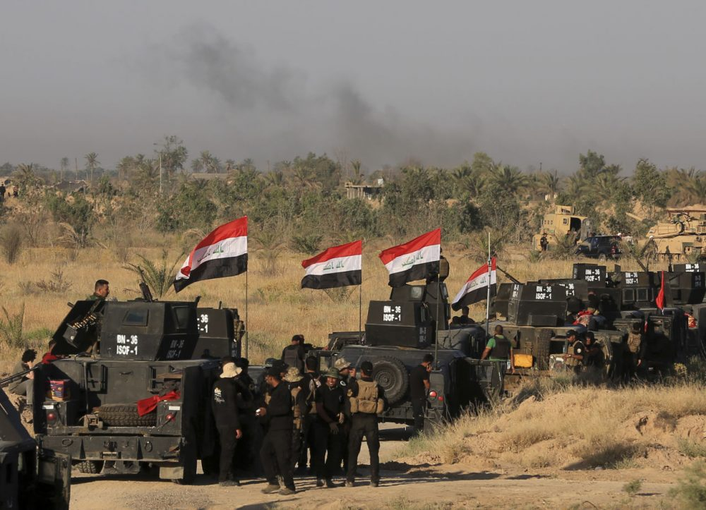 Smoke billows on the horizon as Iraqi military forces prepare for an offensive into Fallujah to retake the city from Islamic State militants in Iraq, Monday. (Khalid Mohammed/AP)
