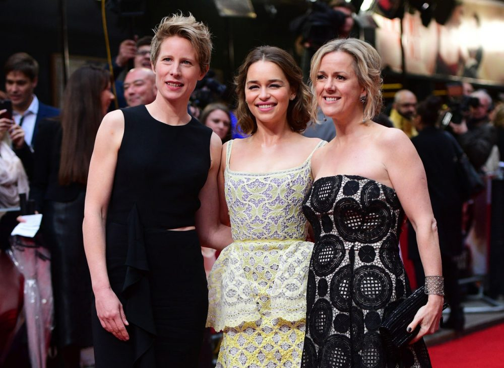 "British actress Emilia Clarke (C) poses for pictures with author Jojo Moyes (R) and director Thea Sharrock (L) as they arrive for the European Premiere of the film ""Me Before You"" in central London, on May 25, 2016. (Leon Neal/AFP/Getty Images)"