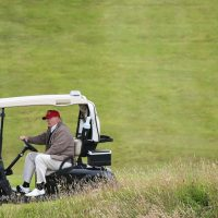 "Frederick Hewett: ""He'll soon realize that he can't afford to maintain his 'it's just the weather' stance."" Presidential contender Donald Trump drives his golf cart on the Turnberry golf course in Turnberry, Scotland, Friday, July 31, 2015. (Scott Heppell/AP)"