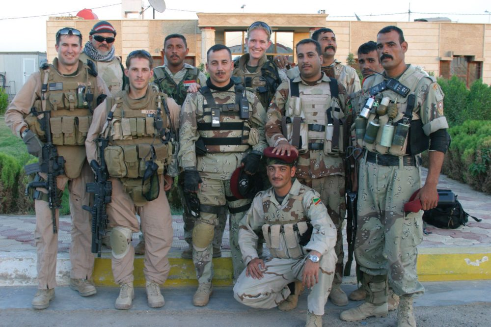 Rep. Seth Moulton, then a Marine Captain, stands alongside both American and Iraqi soldiers in Iraq. Lt. Col Ehab Hashem Moshen is in the center of the second row. (Courtesy, Rep. Seth Moulton)